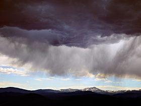 Rocky Mountain Rain by Peter Adams.