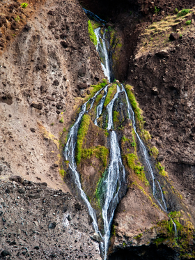Weeping Falls on the Napali Coast of Kauai by Copyright Peter Adams.