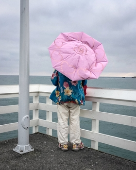 Pink Umbrella by Peter Adams.