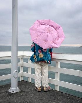 Pink Umbrella by Peter Adams.