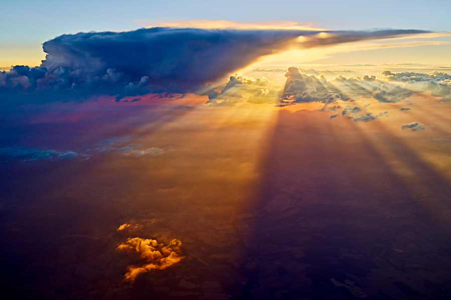 Sunset In The Clouds by Peter Adams.