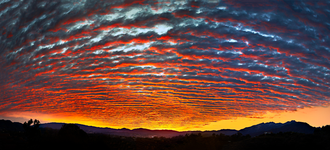 Red Layer Cake Sunset by Peter Adams.