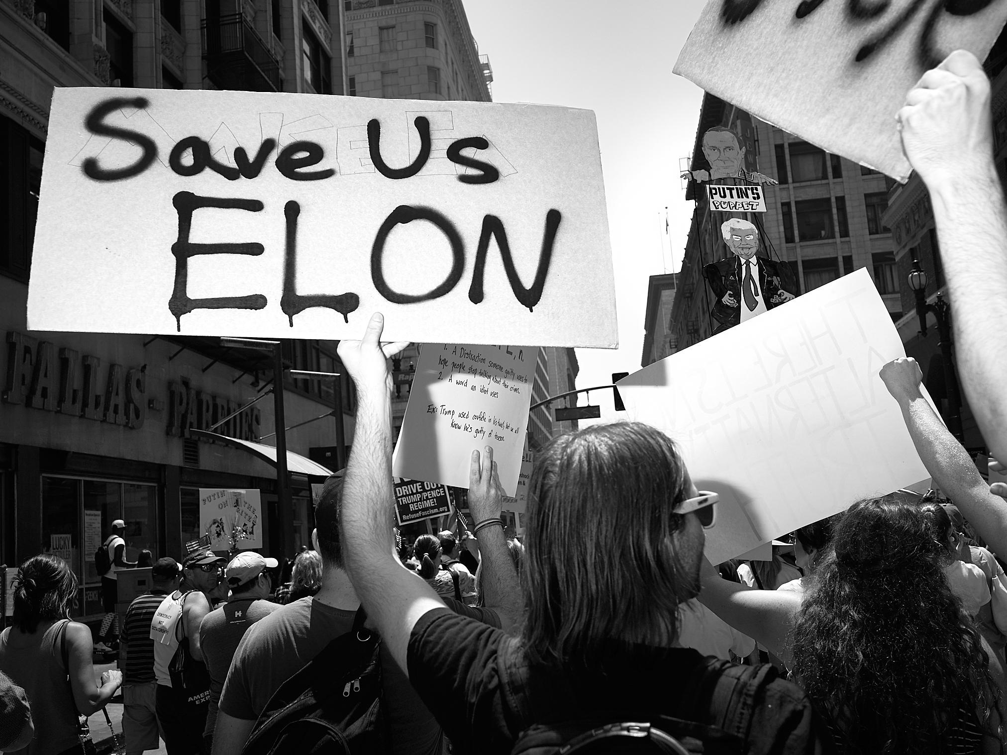 Save us Elon by Peter Adams.