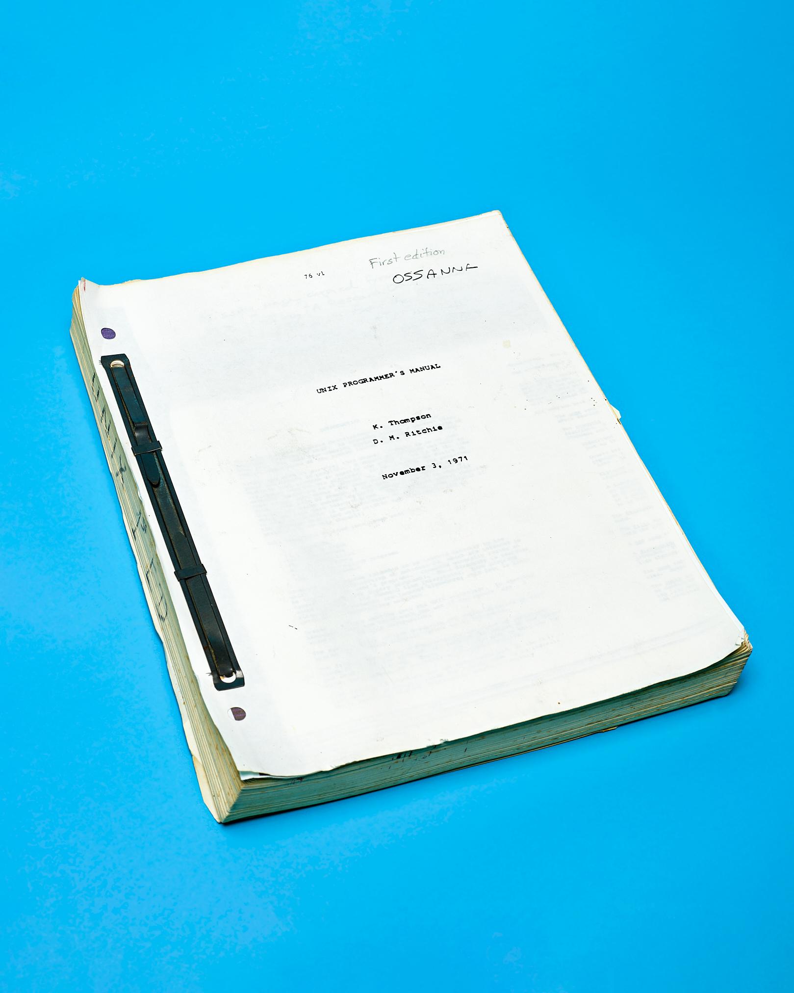 Unix Programer's Manual (1st  Edition) by Peter Adams.