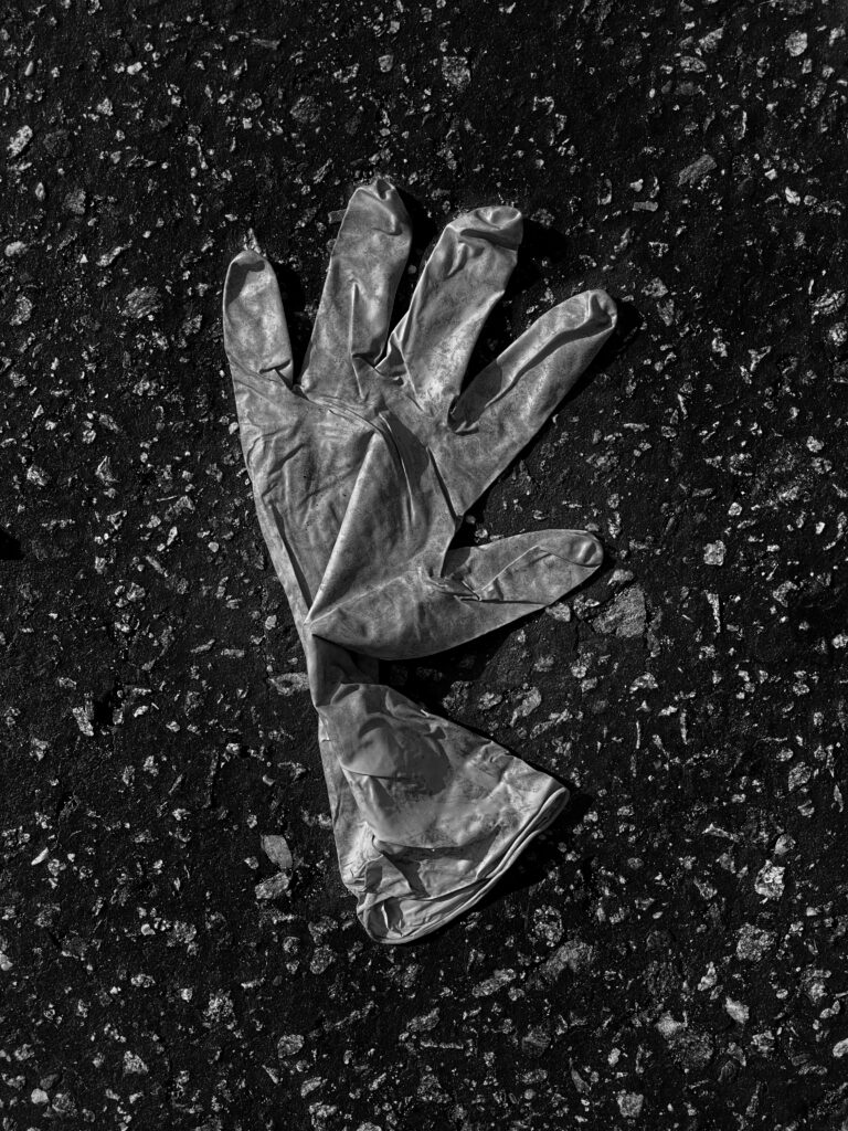 Glove On Street. latex, glove, covid, pandemic, street, asphalt.
